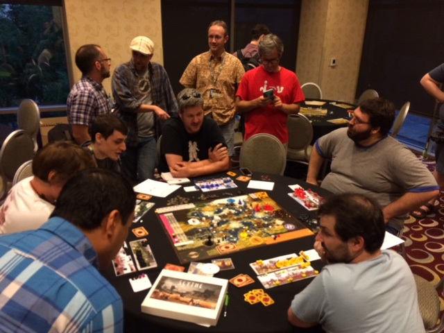 podcasters, bloggers, and video reviewers playtesting Scythe on our media night